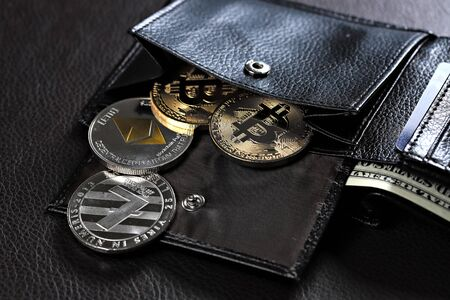 Golden bitcoins in leather wallet, shallow focus