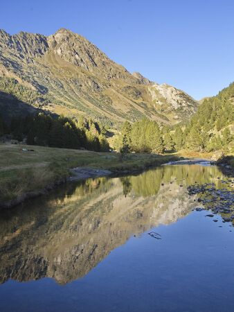 Llanos del hospital, Huesca/Spain; Aug. 21, 2017. Place called Llanos del Hospital belonging to the municipality of Benasque in the heart of the Pyrenees. In the image reflection of the Tuca Salbaguardia peak (2738 m).