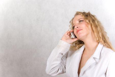 speaks: The girl speaks on a cellular telephone.  Stock Photo