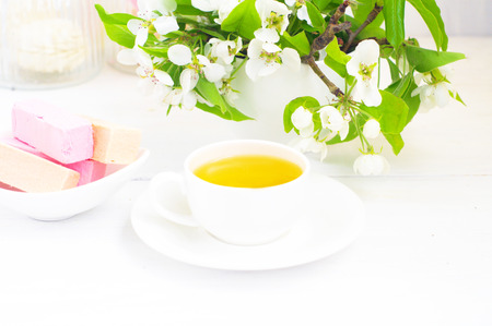 pastila:                      cup of tea and pastila on the white table