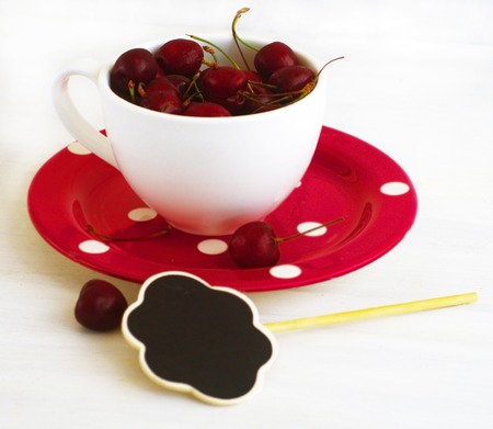 Cherry berries in the big white cup                        photo