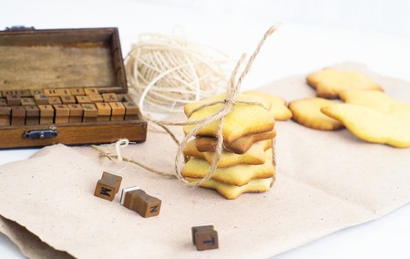 craft paper:     cookies and stamps are lying on the craft paper                           Stock Photo