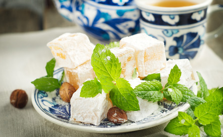 untitled key: Traditional turkish delights ,nuts and fresh mint in typical turkish dish. Selective focus