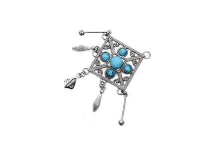 Pendant with blue turquoise mineral stones isolated on white background.