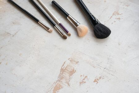 Make up background. Brushes for makeup on the table with copy space.