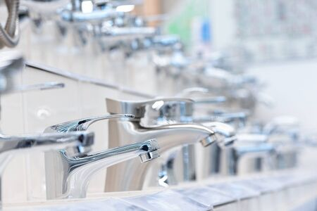 Various new faucets in a construction store.