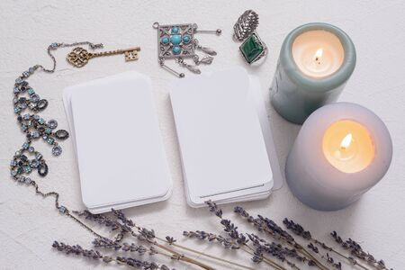 Blank tarot cards with copy space on the white table background.