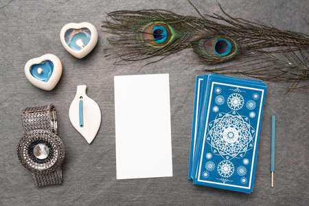 Blue tarot cards deck and blank tarot card with copy space on the stone table surface background.