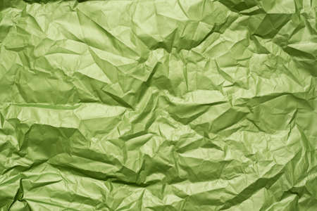 Green crumpled paper texture background.