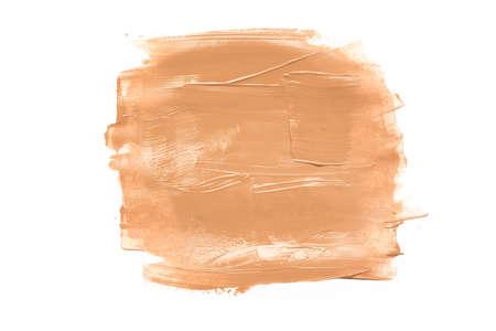 Foundation cream smear isolated on the white background.