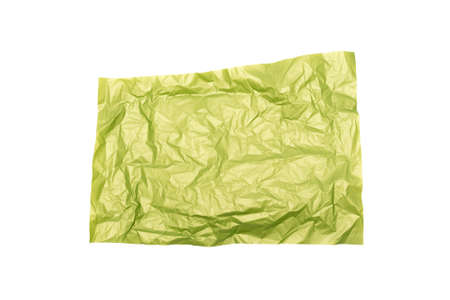 Green crumpled paper page isolated on the white background.