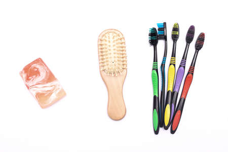 Teeth brush, hair brush and soap isolated on the white background.