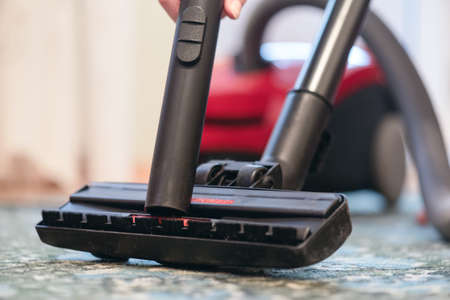 Vacuum cleaner on the floor in the living room close up. Stockfoto