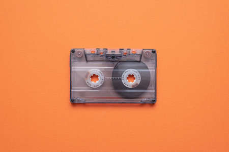 Old retro stereo cassette on the orange flat lay background. Stockfoto