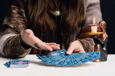 Fortune teller is reading the future with tarot cards close up. Reklamní fotografie