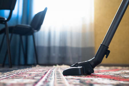Vacuum cleaner on the carpet in the living room.
