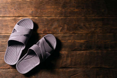 Pair of flip flops shoes on the flat lay floor background with copy space.
