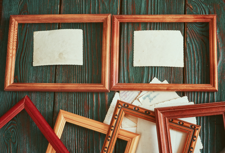 old photograph: Old photos with a wooden framework on an authentic background.