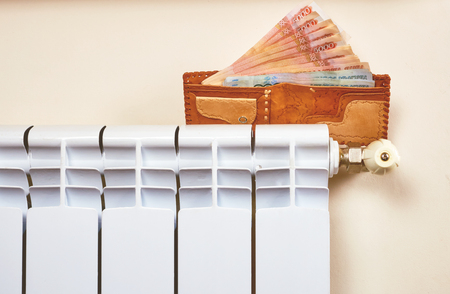 Radiator adjustment to save energy. Save energy and money concept Stock Photo