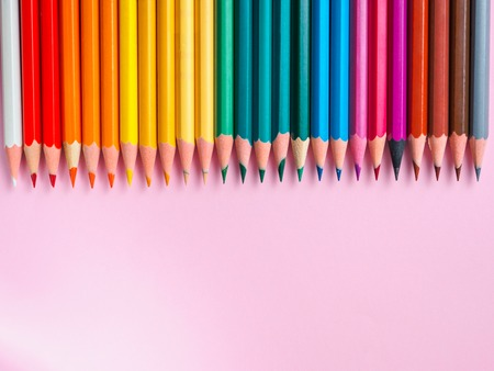 rainbow colors: Colored pencil on pink paper background for drawing. Color circle Stock Photo