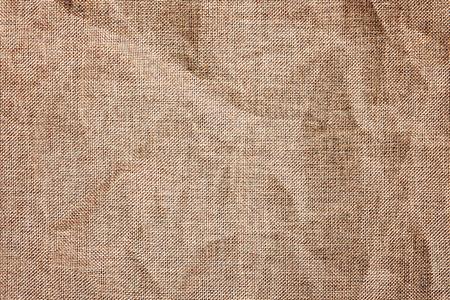 Texture detailed background  jute burlap fabric crumpled vignetting toned macro shot