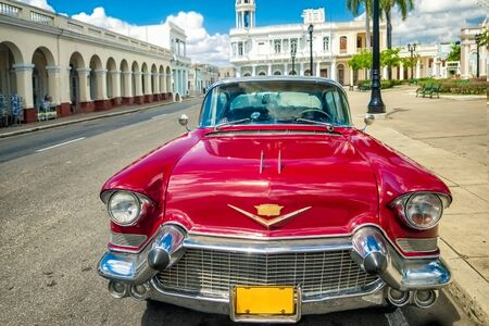 Cienfuegos , CUBA - 22 MARCH 2012 : Red Old retro Car on authentic streets Cuba Cienfuegos