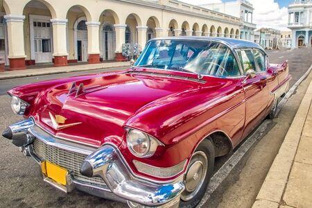 Cienfuegos , CUBA - 22 MARCH 2012 : Red Old retro Car on authentic streets Cuba Cienfuegos