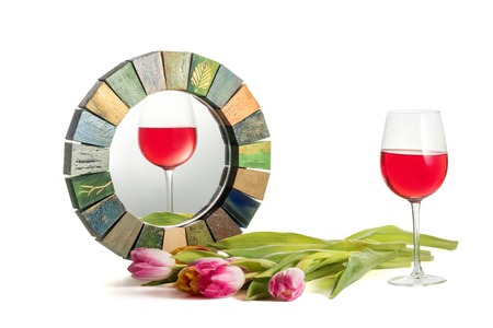 Glass of red rose wine with an inclined horizon reflected correctly in Handmade Mirror