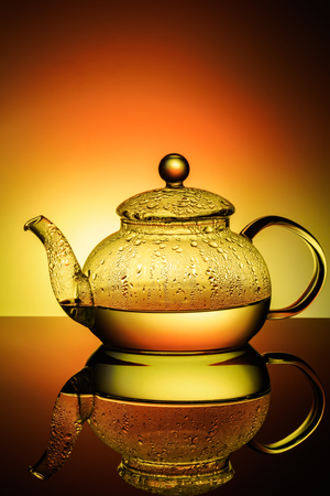 Glass teapot with boiling water and drops of condensation Stock Photo