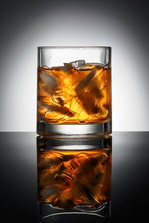 CHELYABINSK, RUSSIA - April 10,2018 Glass of Finest Blended Scotch Whiskey Ballantines Logo Delicious Scotch Whisky Ballantines is produced in Dambarton, Scotland by Pernod Ricard Editorial Photo Editorial