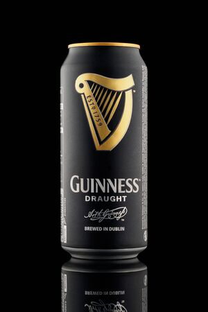 CHELYABINSK, RUSSIA - April 11,2018 Aluminum can of Guinness draught beer advertising shot on black background with realistic reflection Guinness beer one of the most successful beer brands worldwide popular Irish dry stout original traditionally brewed o