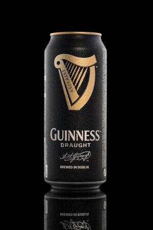 CHELYABINSK, RUSSIA - April 11,2018 Aluminum can of Guinness draught beer advertising shot on black background