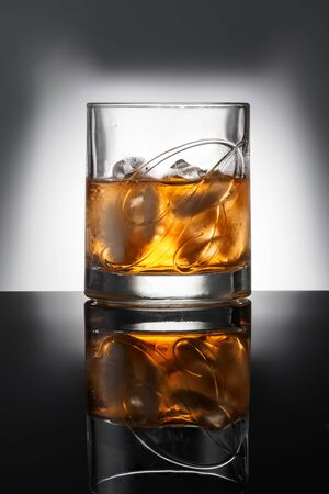 CHELYABINSK, RUSSIA - April 10,2018 Glass of Finest Blended Scotch Whiskey Ballantines Logo Delicious Scotch Whisky Ballantines is produced in Dambarton, Scotland by Pernod Ricard Editorial Photo Redakční