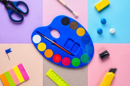 Set of school and preschool childrens accessories for learning letter drawing education on background of multi colored pastel paper Concept Back to school copy space close-up top view. Stok Fotoğraf