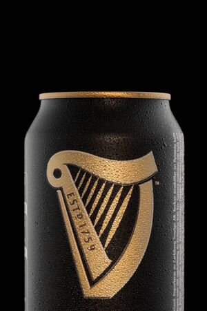 CHELYABINSK, RUSSIA - April 11,2018 Aluminum can of Guinness draught beer advertising shot on black background Editorial