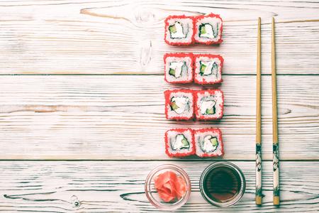 Set of sushi rolls of fresh shrimps cucumber avocado Tobiko caviar and Philadelphia Stock Photo