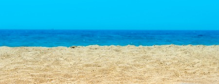 Deserted lonely sandy beach with yellow sand on sea ocean on day in summer Mediterranean heat