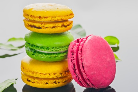 Colorful various French sweet macaroons dessert cake macarons on light background close-up copy space