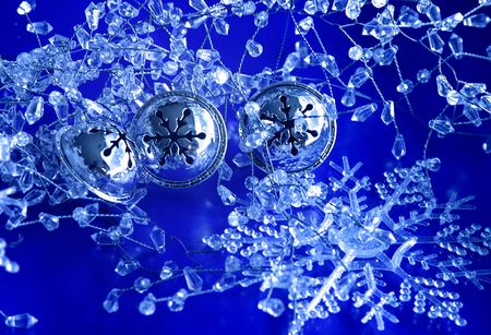 Three silver bells in snow and ice decorations Stock Photo - 653969