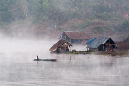 sangkhla buri: Sangkhla Buri, Thailand - January 10: Morning fog around the boat at Sangkhla Buri, Kanchanaburi Province, Thailand on January 10, 2010. Stock Photo