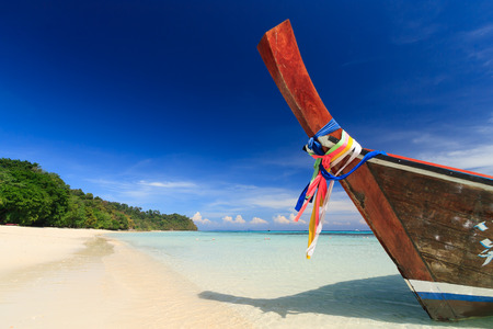 long tail: Long tail boat against blue sky and sea. Koh Rok island, Krabi, Thailand. Stock Photo