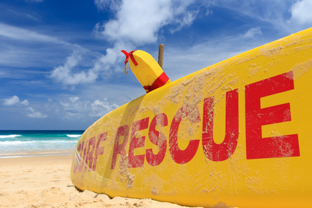 surfing beach: Yellow surf rescue board  by the sea beach. Stock Photo