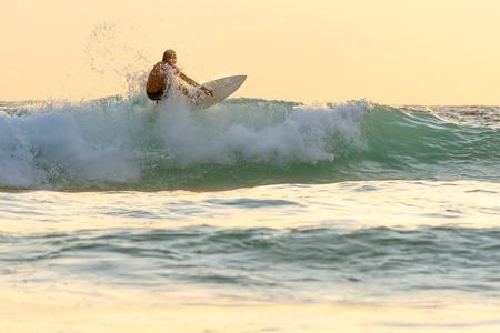 kata: Surfer on the beach at Kata beach, Phuket, Thailand.