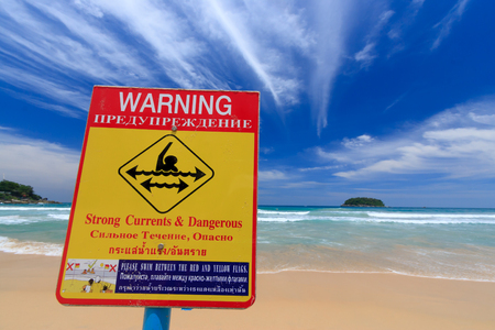 currents: Warning strong currents  dangerous sign English, Russian and Thai language.
