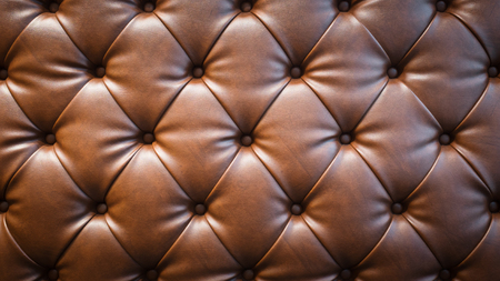brown leather sofa: Brown leather sofa texture background.