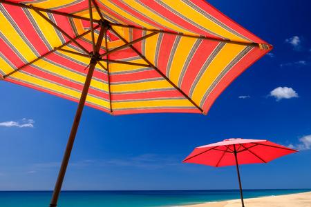 phangnga: Parasol by the beach against blue sky background.  ThaiMuang, Phang Nga, Thailand.
