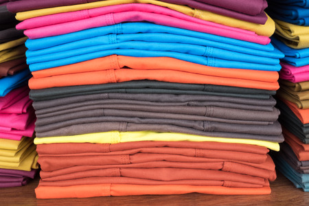 many colored: Stacks of many colored pants. Stock Photo