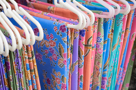 Thai fabric woven batik is sold along the street, Thailand.
