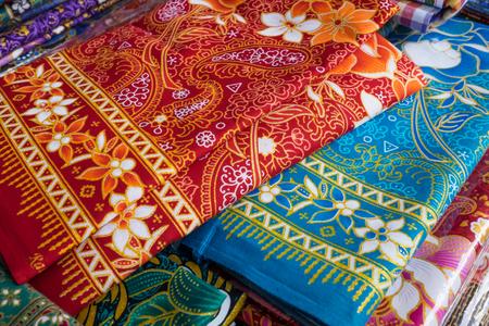 Thai fabric woven batik is sold along the street, Thailand.