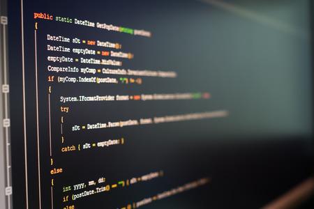 C# computer language source code on computer monitor.